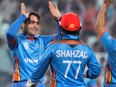 Afghanistan spinner Rashid Khan (left) celebrates the dismissal of Sri Lanka's Lahiru Thirimanne during their ICC World T20 match at Eden Gardens on Thursday. AP