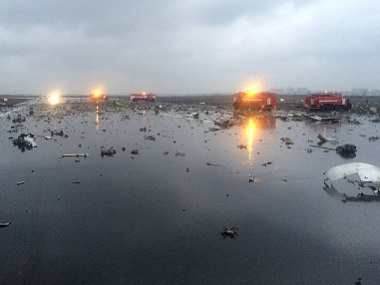 Russian emergency fire trucks are seen among the wreckage of the crashed plane at the Rostov-on-Don airport. vk.com/rostovnadonu group via AP