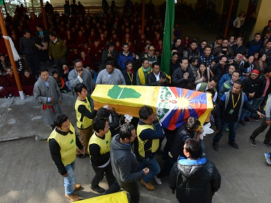 Members of the Tibetan Youth Congress carry the coffin bearing the body of Dorje Tsering during his funeral in McLeod Ganj. AFP