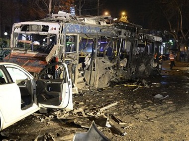Damaged vehicles at the scene of explosion in Ankara on Sunday. AP