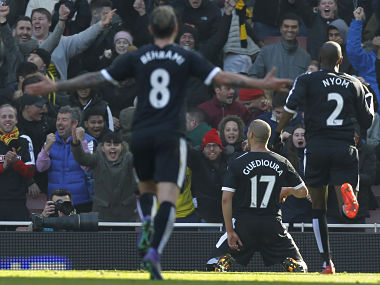 Watford celebrate after scoring against Arsenal in the FA Cup. AFP