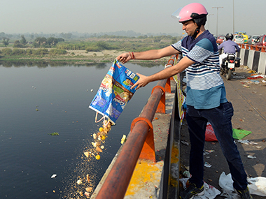 Waste being dumped in the Yamuna river. File photo. AFP