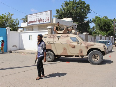 Yemeni security forces gather outside an elderly care home after it was attacked by gunmen in Aden, Yemen. AP