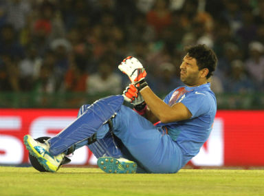 Yuvraj Singh grimaces in pain during the World T20 match against Australia. Solaris Images