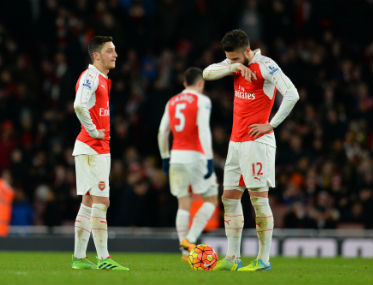Olivier Giroud (right) and Mesut Ozil look dejected after Swansea's second goal against Arsenal at the Emirates on Wednesday. AFP
