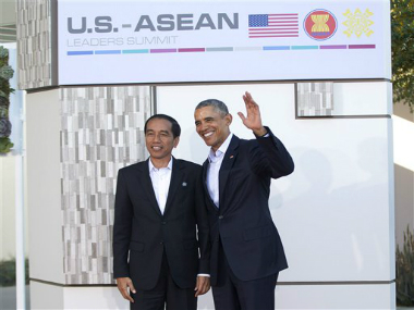 President Barack Obama, right, stands with Indonesian President Joko Widodo. AP