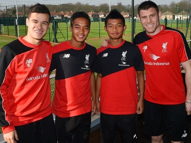 Jerry Mawihmingthanga and Lallianzuala Chhangte with Liverpool stars Philip Coutinho and James Milner. Image courtesy: LFC website