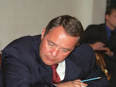 Telecommunication Minister Leonid Reiman (L) and Minister of Press, Television and Radio Broadcasting, Mikhail Lesin (R), confer over documents 28 August 2000 during a meeting, headed by Russian President Vladimir Putin, at the Kremlin in Moscow to discuss the situation concerning the fire at the main TV broadcasting tower in Ostankino. Putin said 28 August 2000 that only an improved economy can help avoid such accidents.   AFP PHOTO   / AFP / POOL