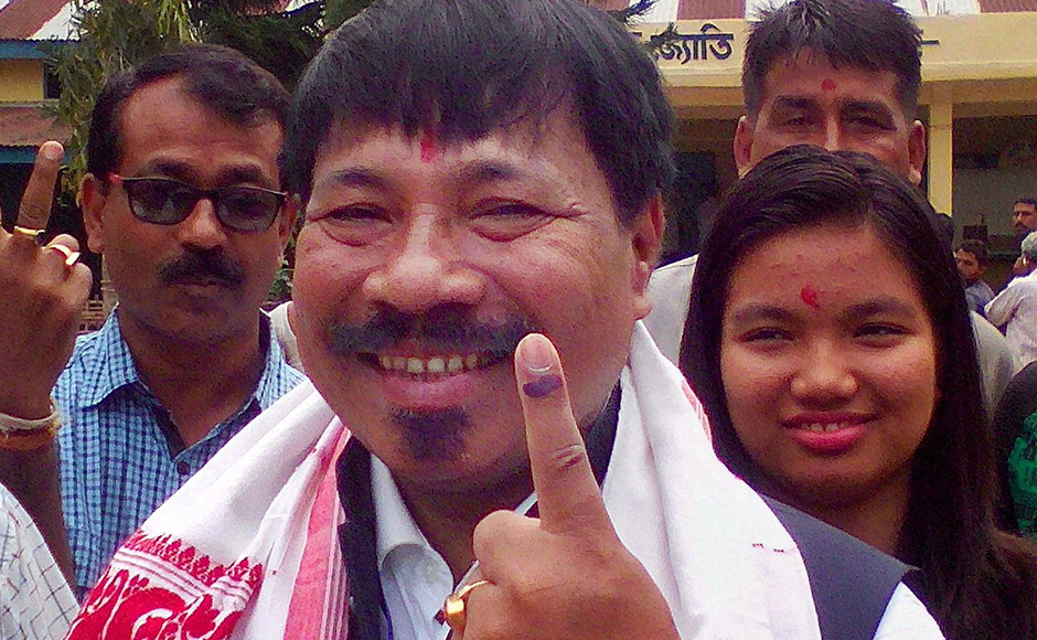 Bokakhat: AGP President Atul Bora and AGP candidate shows his marked finger after casting vote during the first phase of Assam assembly polls in Bokakhat on Monday. PTI Photo