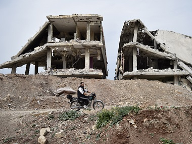 File photo of a heavily damaged building in the rebel held village of Teir Maalah, on the outskirts of Homs. AFP
