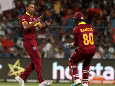 West Indies spinner Samuel Badree (left) celebrates after dismissing England captain Eoin Morgan at the Eden on Sunday. Solaris Images