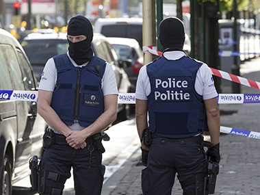 Belgium special forces police secure access during a police operation to search an apartment complex in the Brussels district of Uccle, Belgium, on Tuesday. Reuters