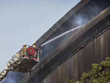 Firefighters try to extinguish a massive fire at the National Museum of Natural History in New Delhi. PTI
