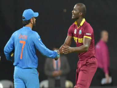 India's captain Dhoni and West Indies captain Sammy after the semi-final. PTI
