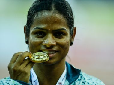 Dutee Chand poses with her winning medal. AFP