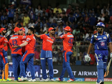 Gujarat Lions players celebrate the wicket of Mumbai Indians captain Rohit Sharma. BCCI