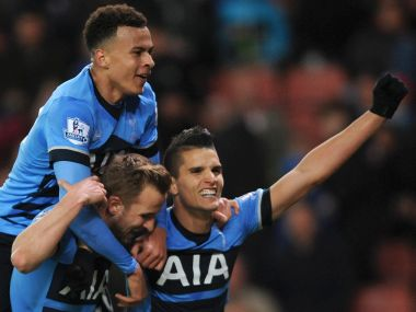 Harry Kane celebrates scoring a goal with Dele Alli and Erik Lamela. AP