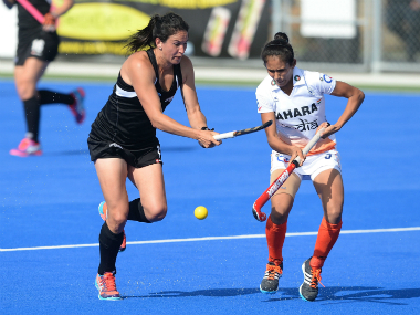 Kayla Whitelock of New Zealand and Deep Grace Ekka (right) of India control a high ball. Getty Images