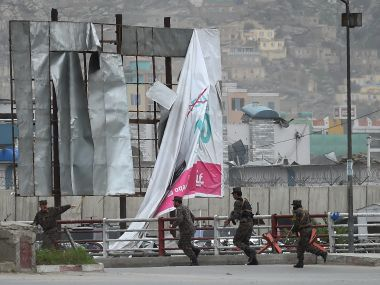 Afghanistan security personnel arrive at the site of the blast in Kabul on Tuesday. AFP