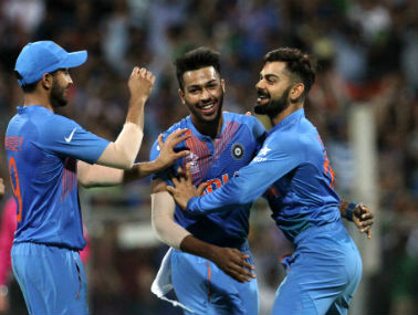 Virat Kohli (right) celebrates with teammates after dismissing Johnson Charles at the Wankhede on Thursday. Solaris Images