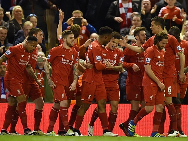 Liverpool players celebrate after scoring a goal. AFP