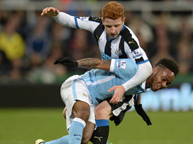 Newcastle United's Jack Colback (up) vies with Manchester City's  Raheem Sterling match between Newcastle United and Manchester City. AFP
