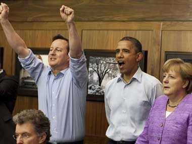 A file photo of UK PM Cameron, US President Obama and German Chancellor Merkel. Reuters