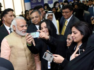 Narendra Modi poses for a selfie with IT professionals working in TCS during his visit to Saudi Arabia. PTI