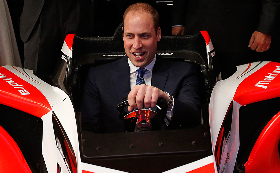 Britain's Prince William, Duke of Cambridge drives a Formula E simulator as he attends a Young Entrepreneurs Event in Mumbai on April 11, 2016. / AFP PHOTO