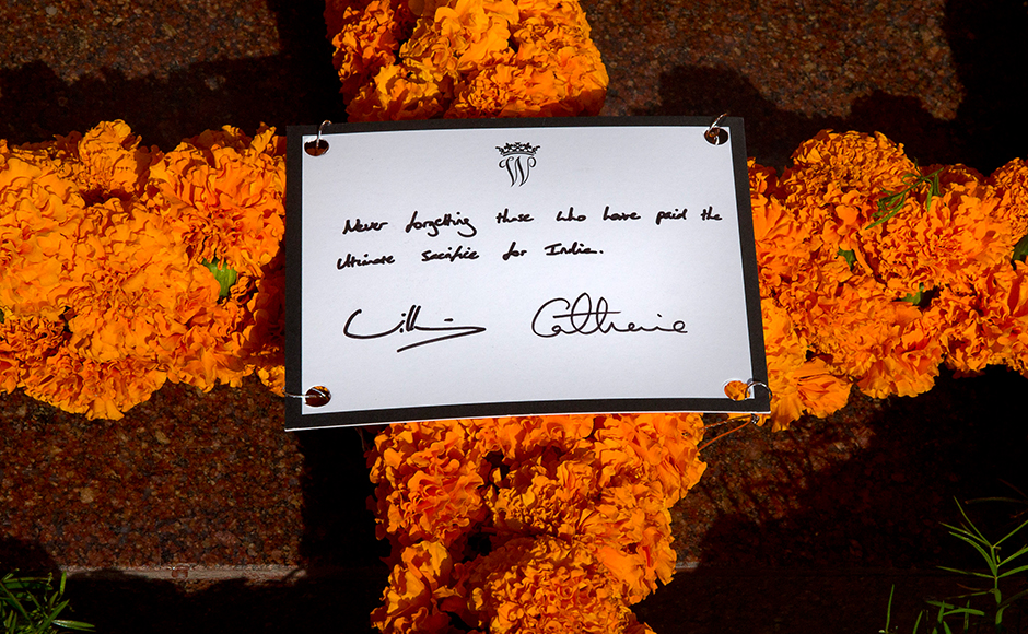 Detail on the card on a wreath laid by Britain's Prince William,Duke of Cambridge along with his wife Catherine, Duchess of Cambridge as they paid tribute at the India Gate war memorial, in the memory of the soldiers from Indian regiments who served in World War I, in New Delhi on April 11, 2016. AFP