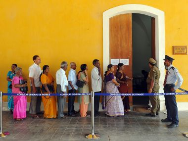 A file image of people queuing up to cast their vote in Puducherry. AFP