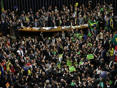 Opposition lawmakers celebrate after the lower house of Congress voted to impeach Brazil's President Dilma Rousseff. AP