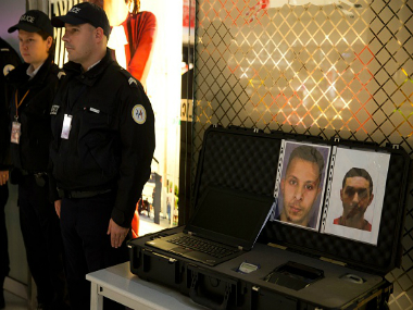 olice officers stand next to the wanted notice of terrorist Salah Abdeslam (L) and Mohamed Abrini. Getty Images.