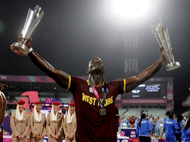 Darren Sammy poses with the ICC World T20 trophy. AFP