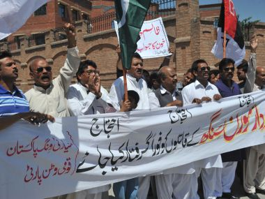 Pakistani activists from the Qaumi Watan Party protest against the killing of provincial minister for minority affairs Sardar Soran Singh. AFP PHOTO