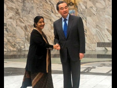 Sushma Swaraj meets China's External Affairs Minister Wang Yi. Image courtesy: Twitter/@MEAIndia