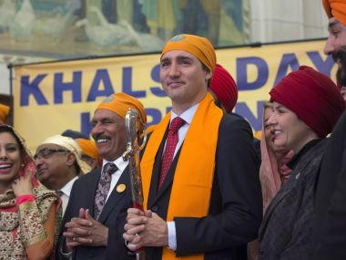 Members of the Sikh Caucus surround Prime Minister Justin Trudeau. AP