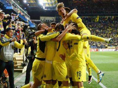 Villarreal players celebrate their goal. AP