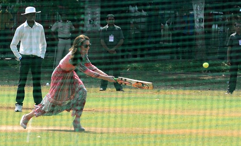 She's a good sport! Kate takes a swing at the nets. Image by Sachin Gokhale