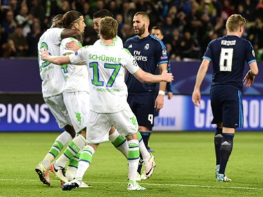 Wolfsburg players celebrate after scoring a goal against Real Madrid. AFP