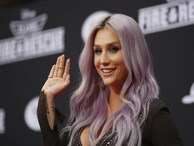 """Recording artists Kesha arrives to the premiere of """"Planes: Fire & Rescue"""" at the El Capitan Theater in the Hollywood section of Los Angeles, California, July 15, 2014.  REUTERS/David McNew/Files"""