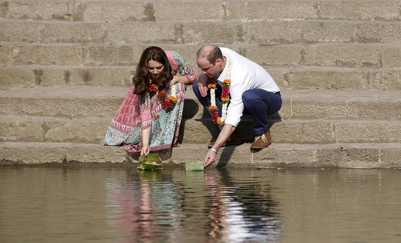 Britain's Prince William and his wife Catherine, Duchess of Cambridge, float flowers at the Banganga Water Tank in Mumbai, India, Sunday, April 10, 2016. REUTERS/Rajanish Kakade/Pool TPX IMAGES OF THE DAY