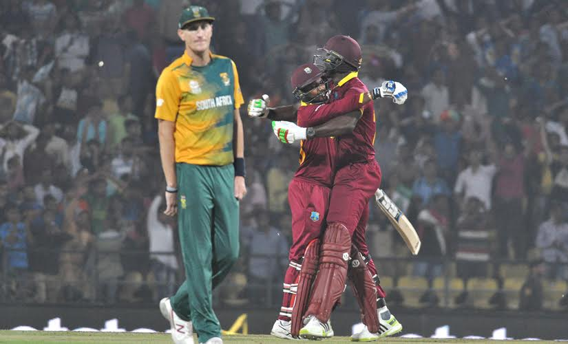 Carlos Brathwaite and Denesh Ramdin celebrate after winning against South Africa. Solaris Images