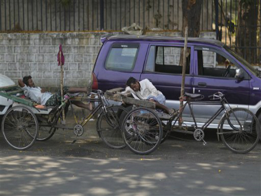 Rickshaw pullers rest in the shade. AFP
