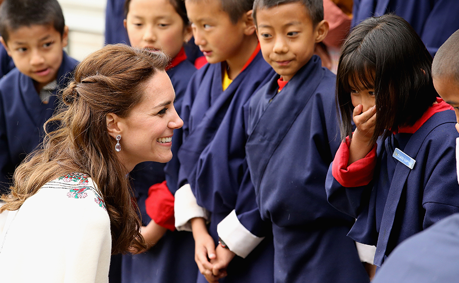 Catherine, Duchess of Cambridge meets children before a Bhutanese archery demonstration on the first day of a two day visit to Bhutan on the 14th April 2016 in Paro, Bhutan. The Royal couple are visiting Bhutan as part of a week long visit to India and Bhutan that has taken in cities such as Mumbai, Delhi, Kaziranga, Bhutan and Agra. Getty