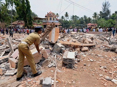 A view of a collapsed building after a massive fire broke out during a fireworks display in Kerala on Sunday. PTI