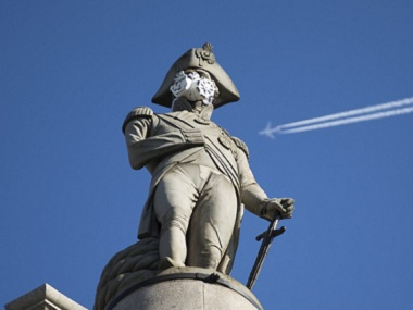 A clean air mask is seen placed on the top of Nelson's Column by Greenpeace activists to protest against air pollution quality in London. AP
