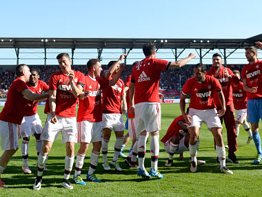 Bayern Munich players celebrate wining the league for the fourth year in a row. AFP