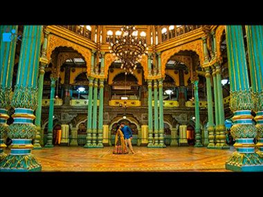 The pre-wedding photo shoot inside the Durbar Hall in the Mysore Palace drew ire from all quarters. Photo courtesy: YouTube/7 Rainbows