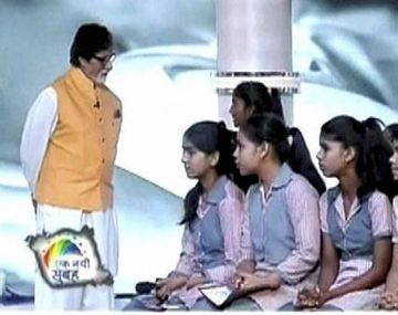 Actor Amitabh Bachchan interacts with a girl in the Beti Bachao Beti Padhao programme at the mega bash organised to highlight the NDA government's achievements in the two years, at India Gate in New Delhi on Saturday. PTI